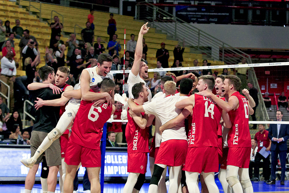 2019 April 30 SPT - PHOTO BY VICTOR M. POSADAS / SPECIAL TO THE HONOLULU STAR-ADVERTISER  The Lewis University Men's Volleyball team celebrate after defeating USC in their 2019 NCAA Men's Volleyball Championship opening round match on Tuesday, April 30, 2019, at the Long Beach State Walter Pyramid in Long Beach, CA.